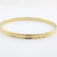 Armring i 14 karat guld med prægning. Billig guld armring