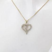 Diamant hjerte 0,25 ct med tilhørende guldhalskæde i 9 karat