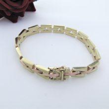 Facetteret murstens armbånd i 8 karat guld og rødguld